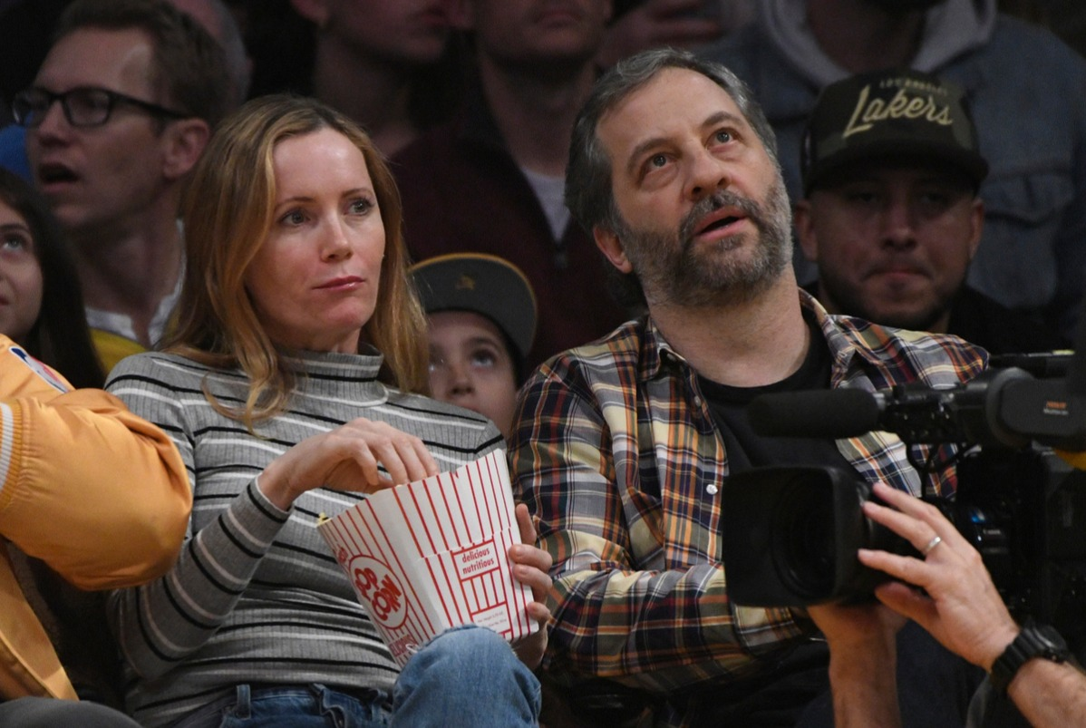 Judd Apatow and Leslie Mann watch the Los Angeles Lakers play the Phoenix Sunsat Staples Center