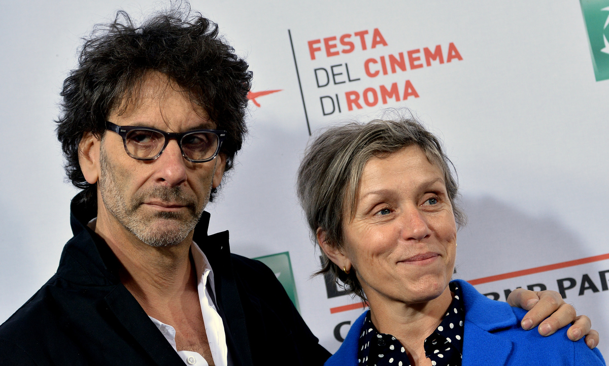 US actress Frances McDormand (R) and US director Joel Coen pose during a photocall before meeting the audience at the Rome Film Festival