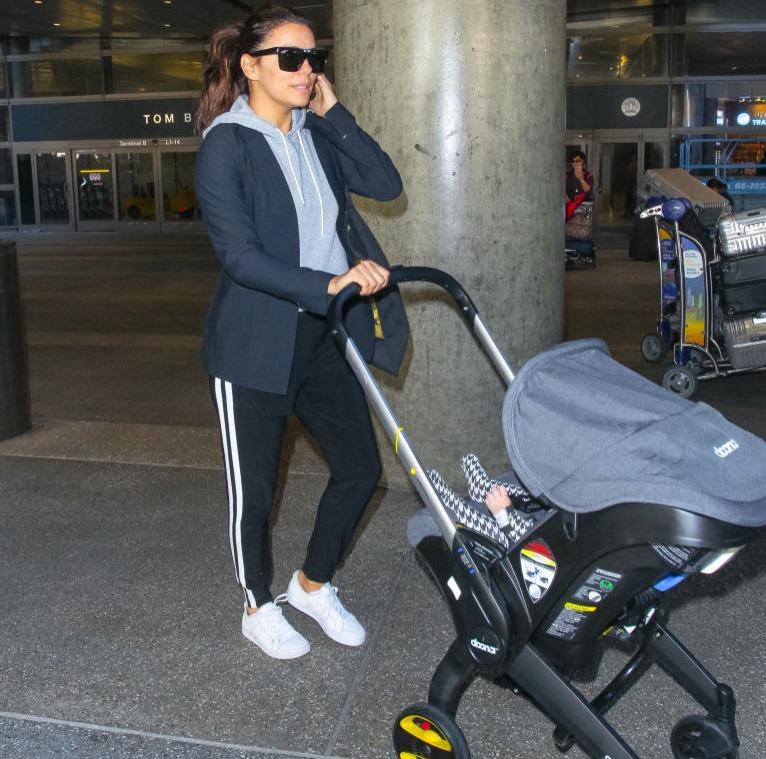 Eva pushing a stroller