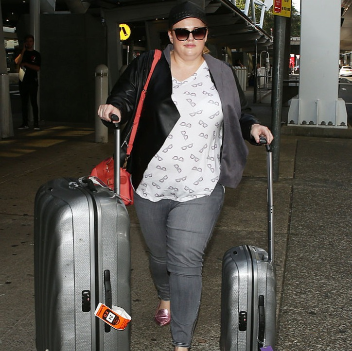 Rebel walks with two suitcases