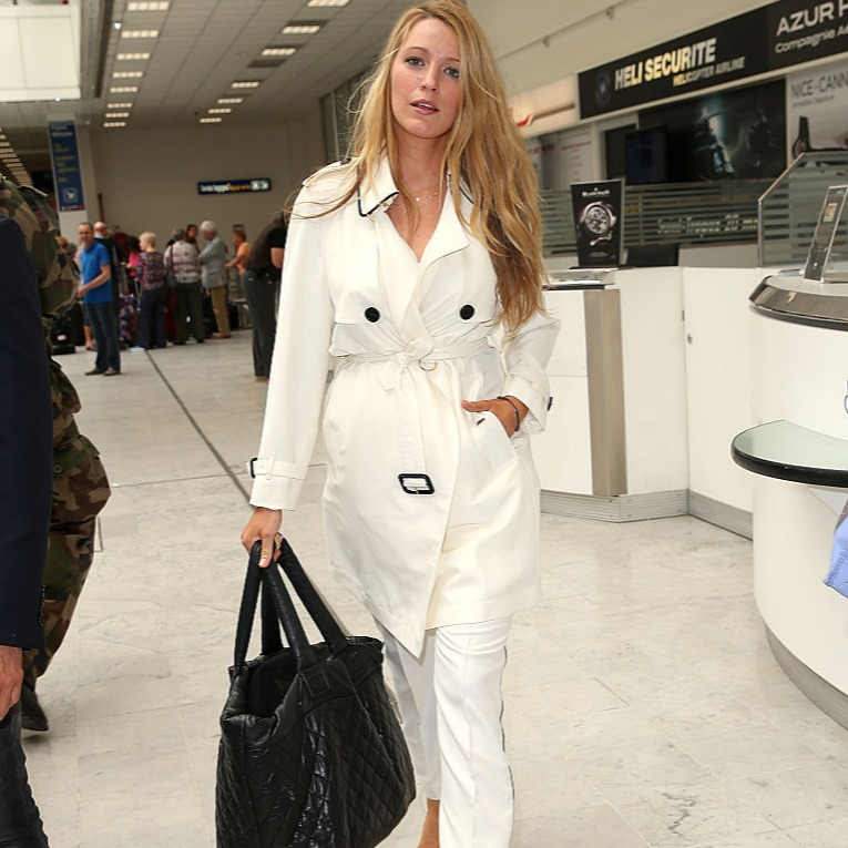 Blake Lively wears a white trench coat