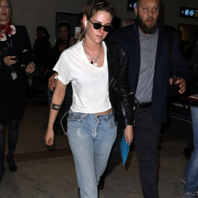 Kristen Stewart in a white t-shirt and leather coat