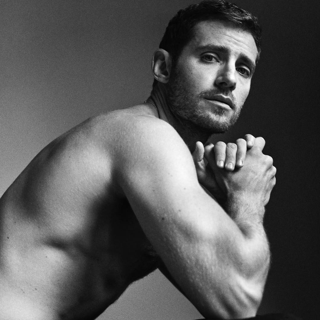 black and white picture of julian morris showing his muscles