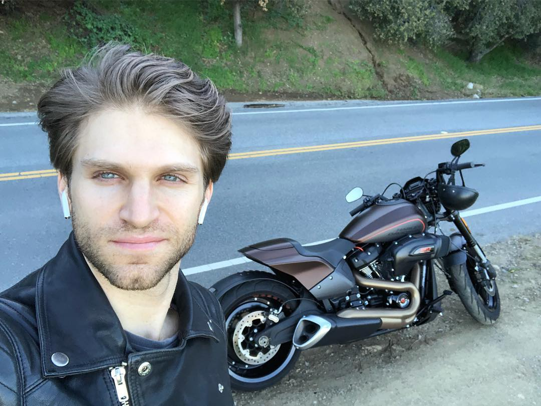 keegan allen on side of road with motorcycle