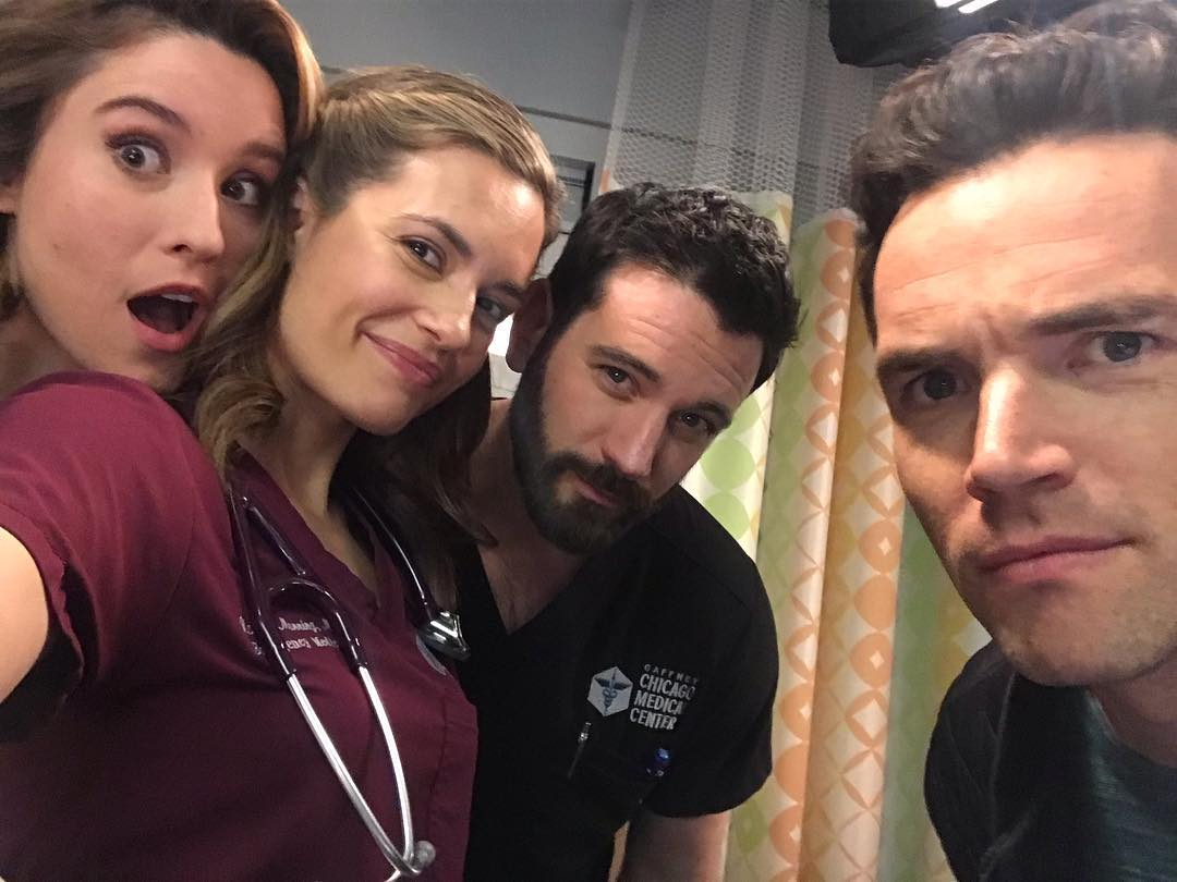 torrey devitto and cast on the set of chicago med