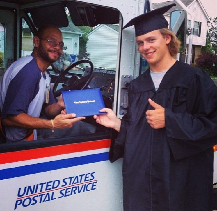 student graduates with mail man