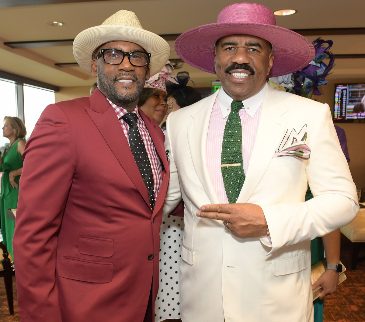 Guest and Steve Harvey attend the 145th Kentucky Derby at Churchill Downs on May 04, 2019 in Louisville, Kentucky.
