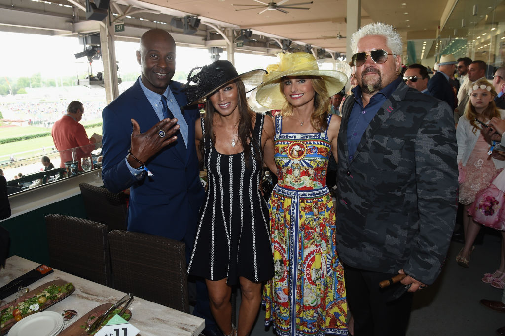 Jerry Rice, Colleen Murray, Giada De Laurentiis, and Guy Fieri attend the 143rd Kentucky Derby at Churchill Downs