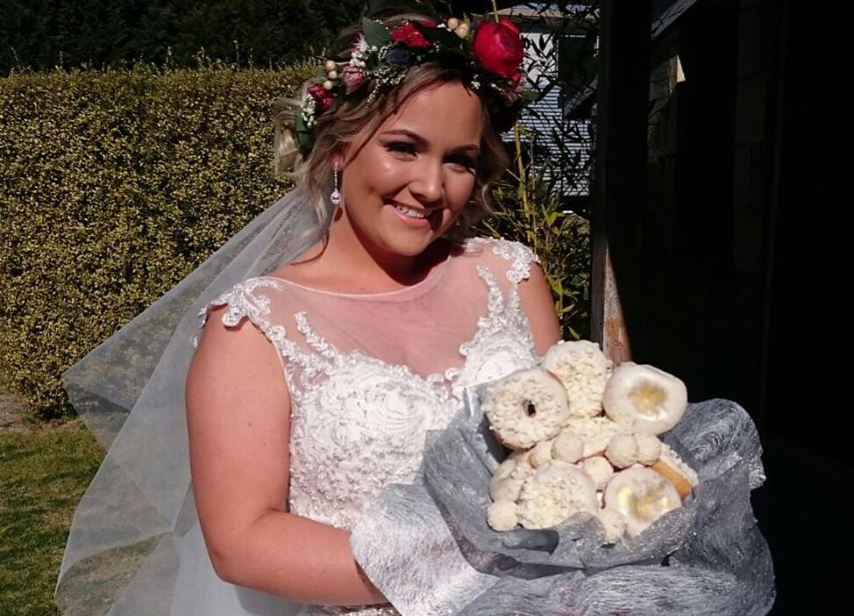Bride holding a powdered donut bouquet
