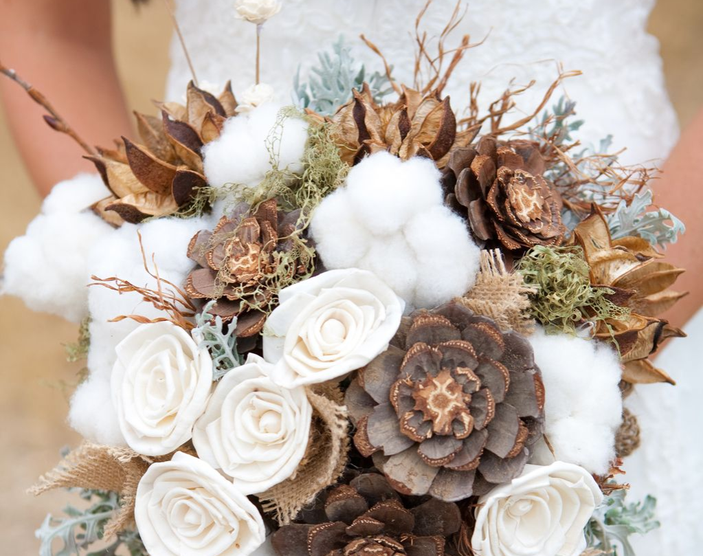 Cotton ball bouquet with pincones, dry leaves, and twigs