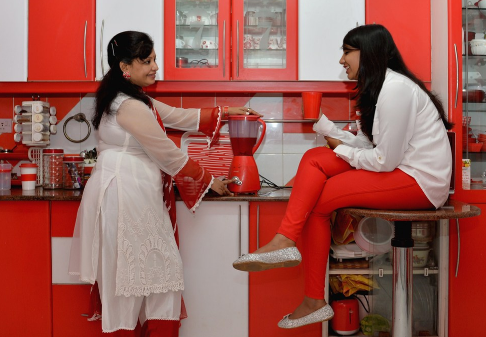 Family's red and white kitchen in Bangalore, India