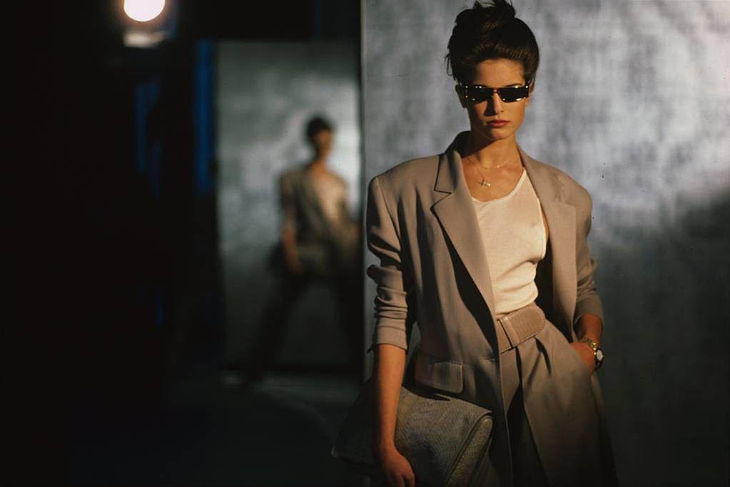 Model Stephanie Seymour in Donna Karan's tan wool gabardine suit