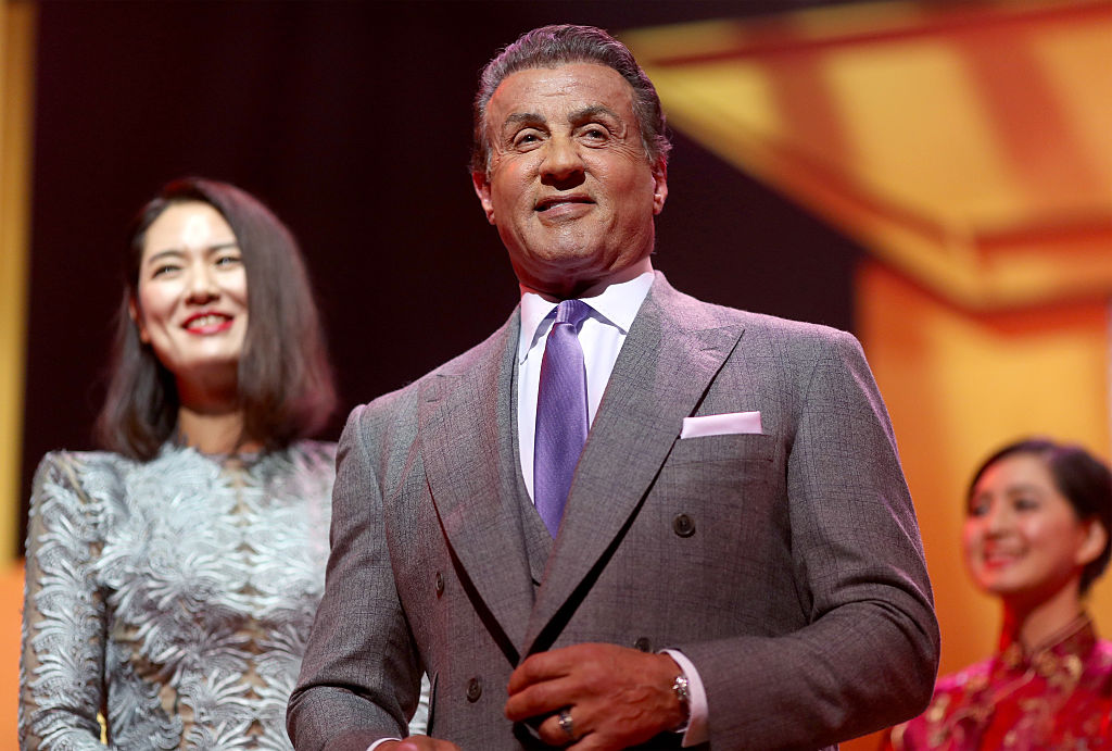 Sylvester Stallone accepts the Lifetime Achievement Award onstage during the 21st Annual Huading Global Film Awards