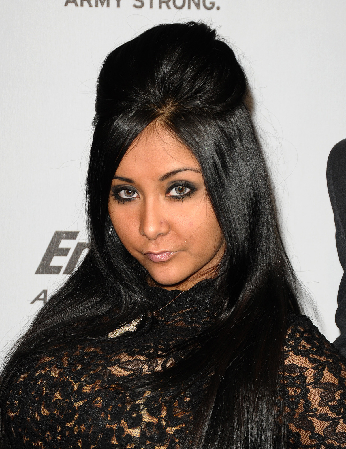 "TV personality Nicole ""SNOOKI"" Polizzi with hair poof"