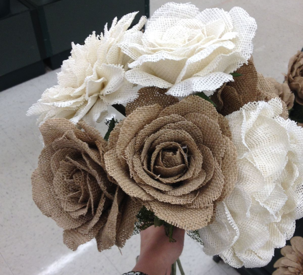 person holding burlap flowers bouquet in Hobby Lobby