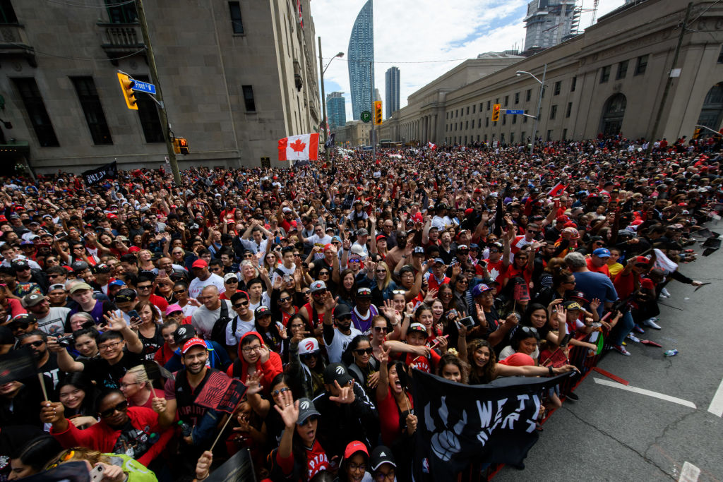 Fans cheer as they wait for the Toronto Raptors Championship parade-1150381198