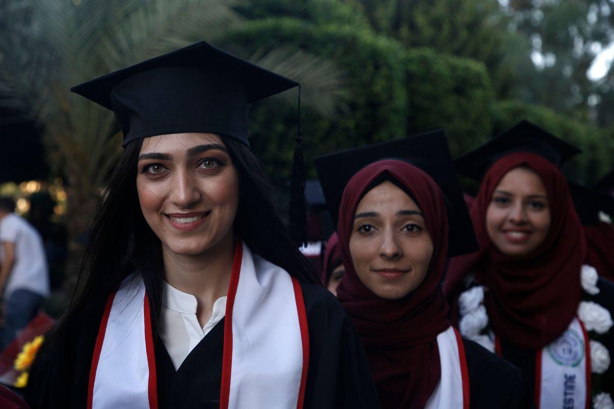 women graduating smiling