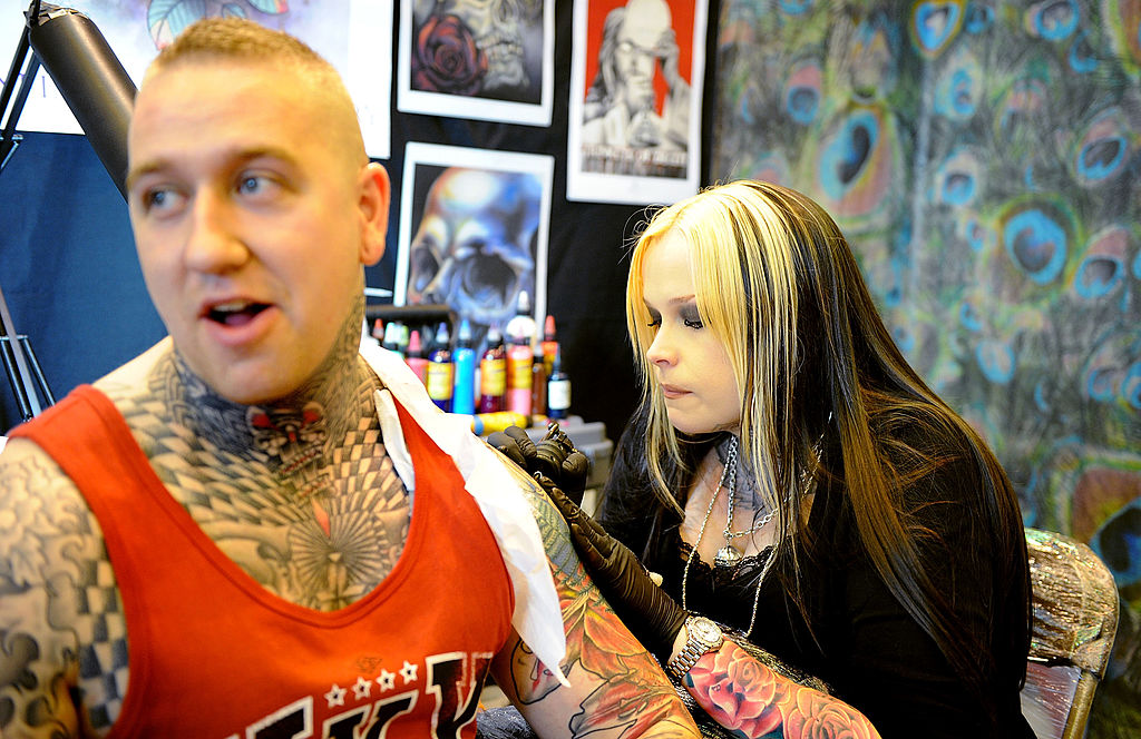 A Tattoo Artist creates a new piece of art at The Manchester International Tattoo Show on August 4, 2012-149832348