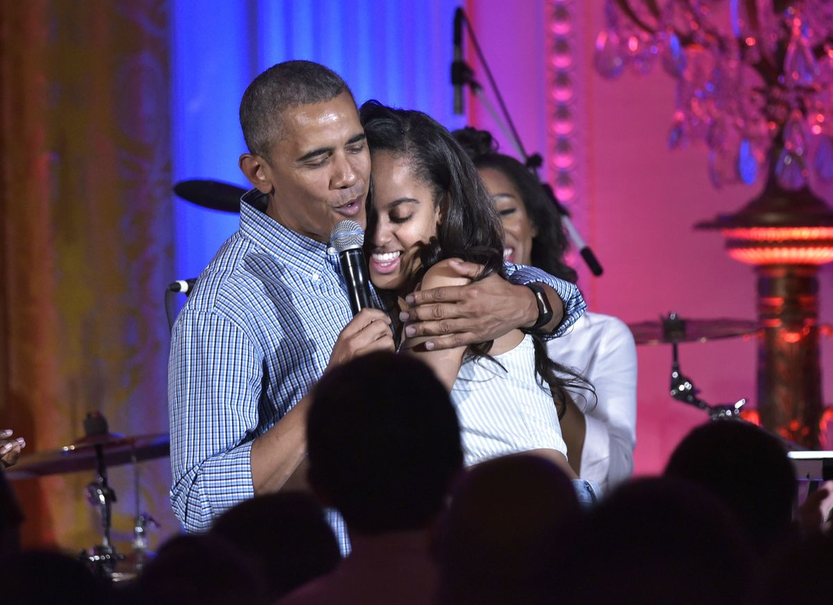 Malia and Barack hugging at speech in 2016