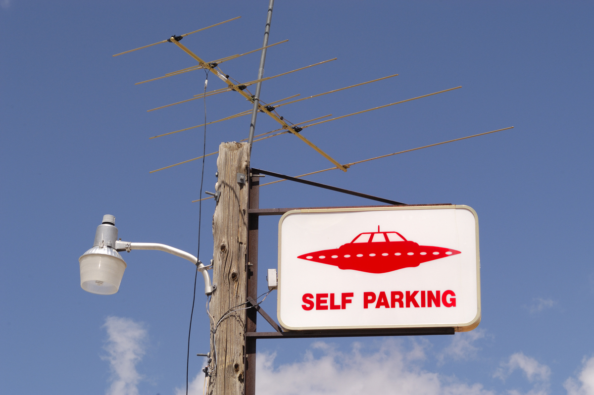 sign for ufo parking at gas station near Area 51 in Nevada