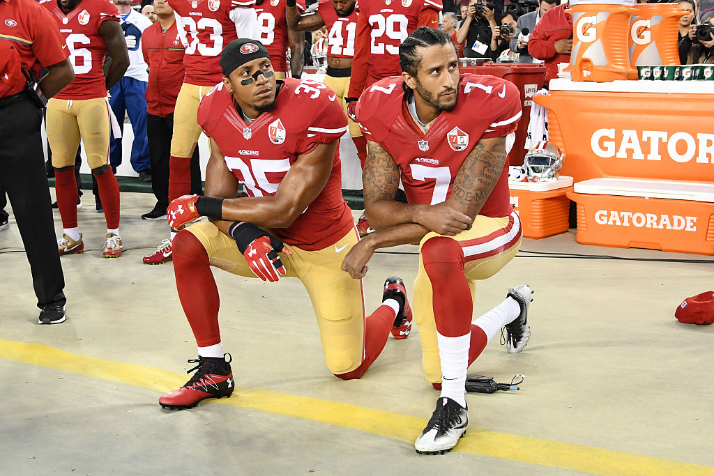 San Francisco 49ers kneel in protest during the national anthem prior to playing the Los Angeles Rams in their NFL game-603553668