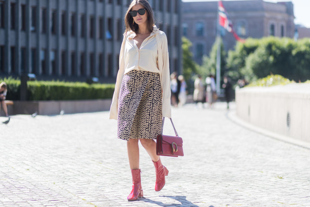 Darja Barannik wearing white blouse, skirt, red Gucci bag and red boots outside IBEN -837508692