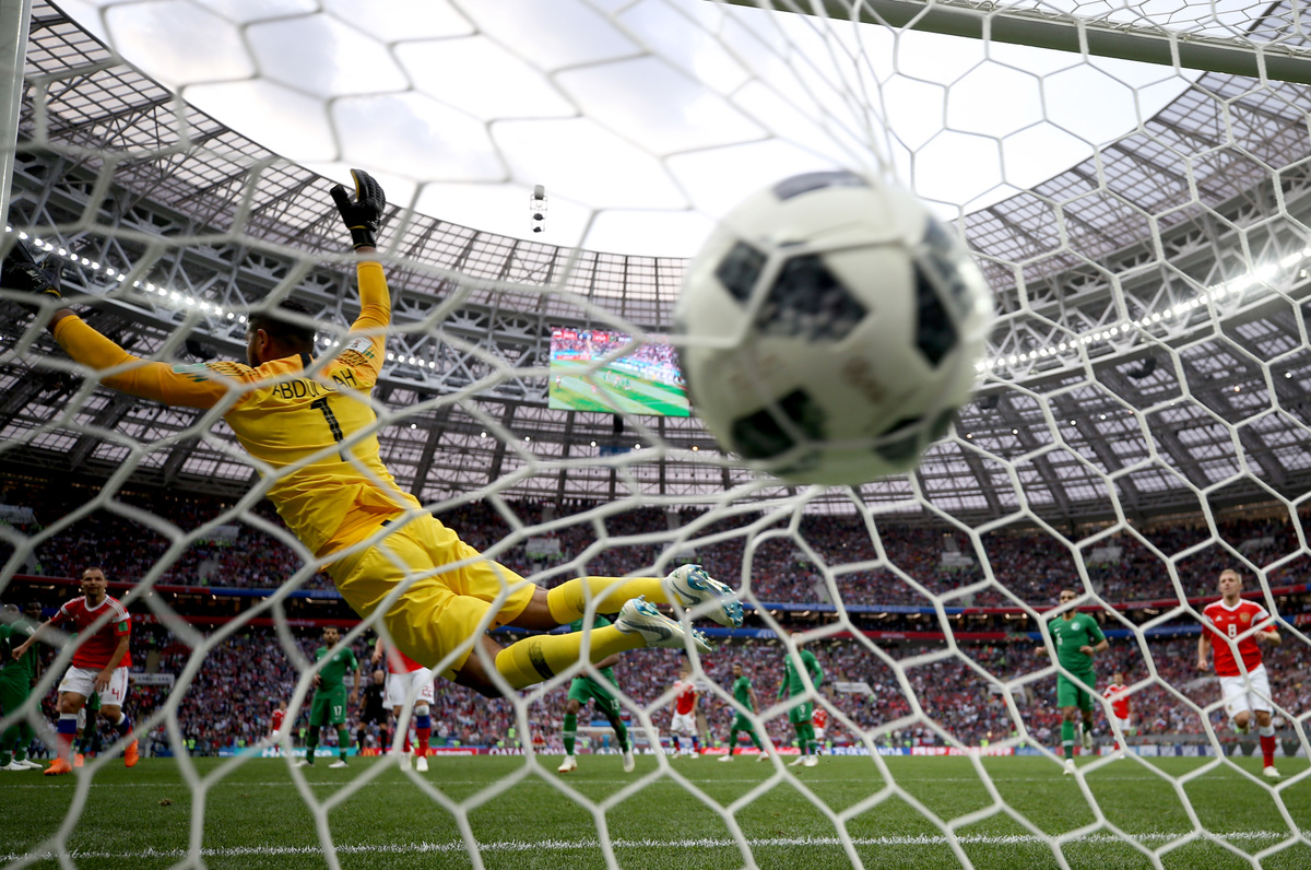 Aleksandr Golovin of Russia scores his team's fifth goal past Abdullah Al Muaiouf of Saudi Arabia during the 2018 FIFA World Cup Russia Group A match between Russia and Saudi Arabia at Luzhniki Stadium on June 14, 2018 in Moscow, Russia.