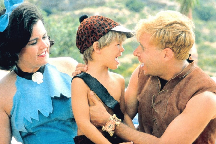 Betty and Barney Flintstones with kid smiling love action rosie o donnel