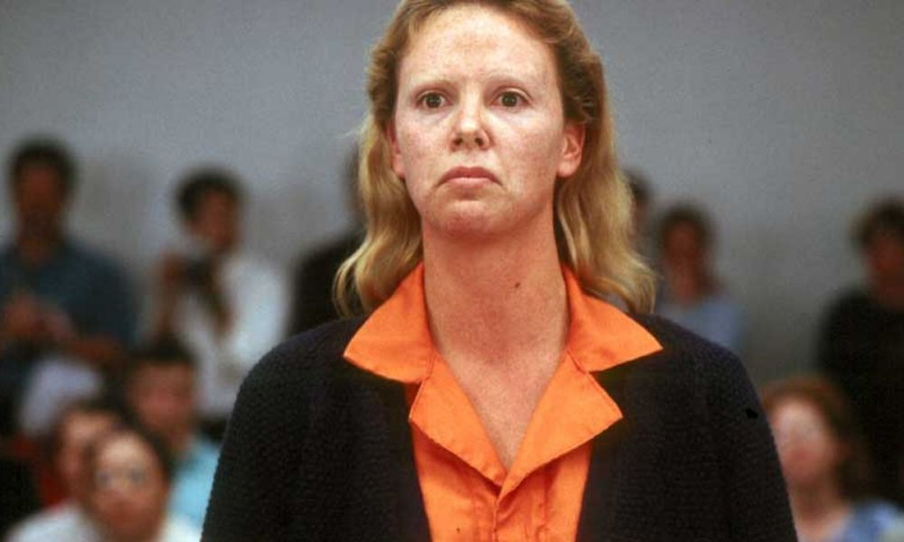Charlize Theron monster aileen wuornos in court scene staring down the camera
