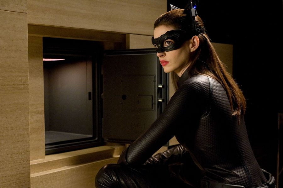 anne hathaway catwoman opening a safe
