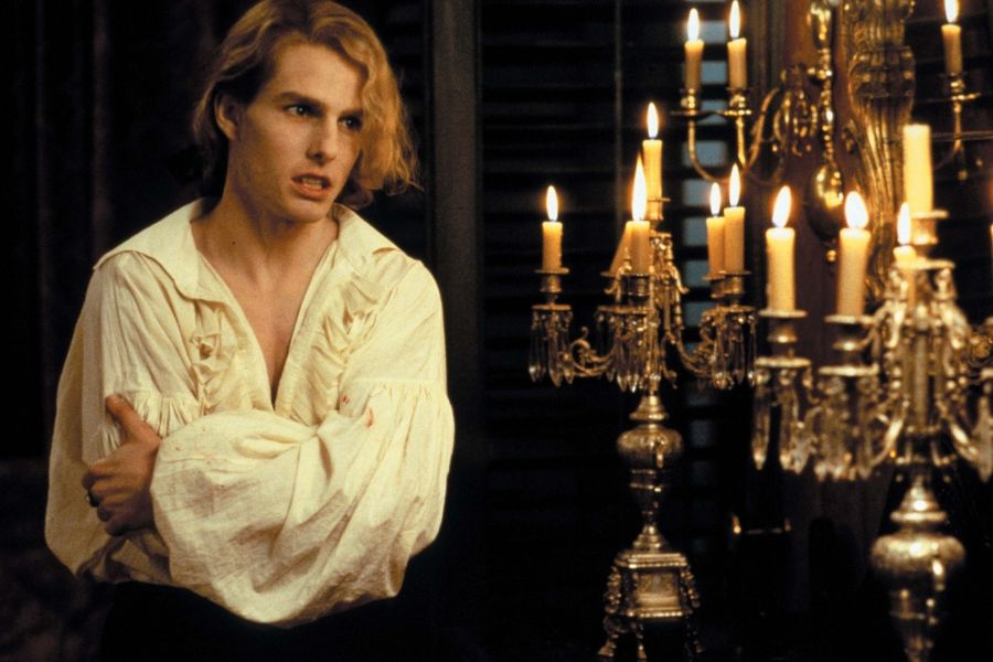 tom cruise lestat interview with the vampire he looks moody standing beside a candelabra in a dark room