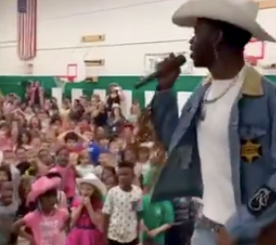 lil nas x performing at an elementary school