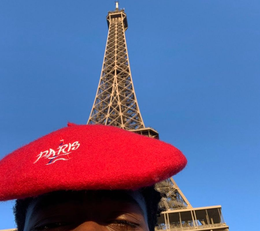 lil nas x in front of eifell tower paris in a red beret