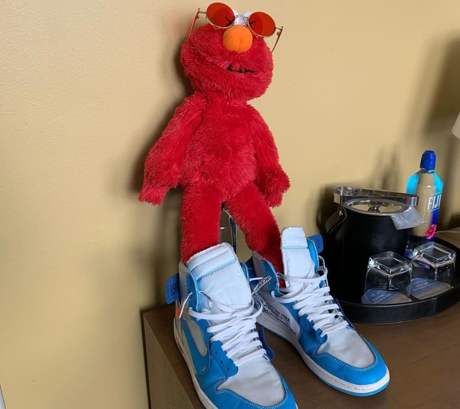 bro elmo in sneakers and sunglasses