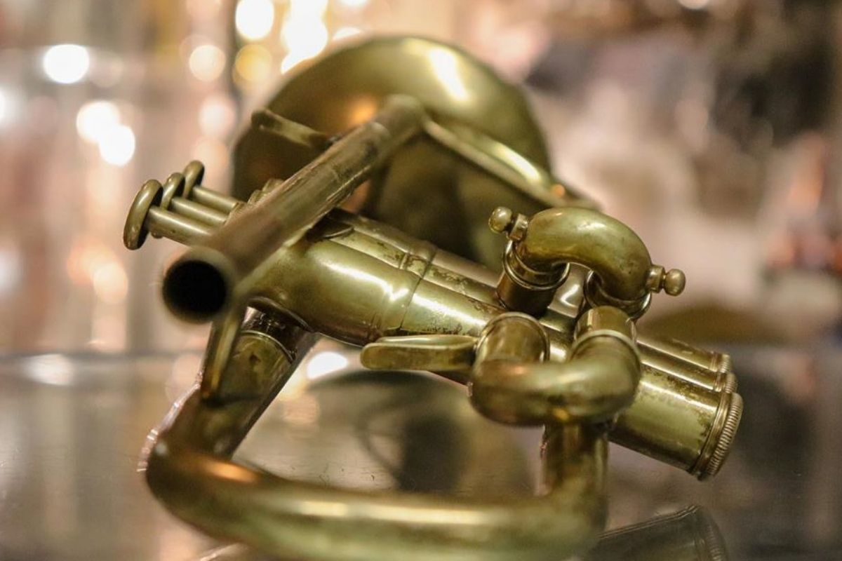 brass trumpet laying on table