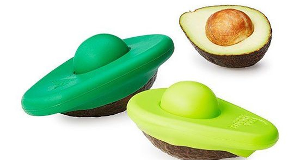 avocado lids in dark and lime green and an exposed half of an avocado with a pit