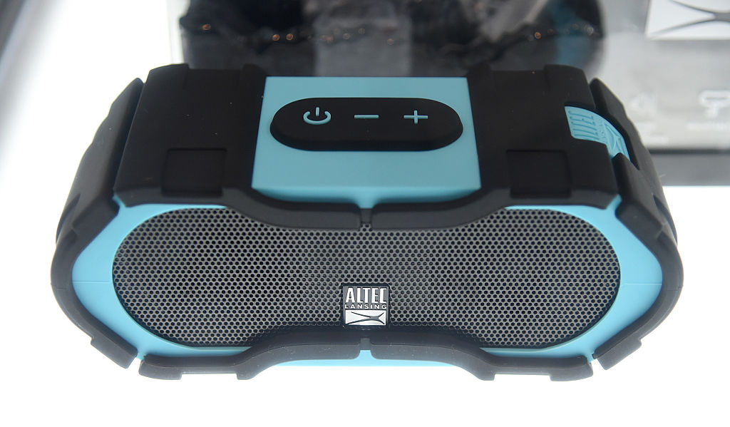 a black and blue portable bluetooth speaker