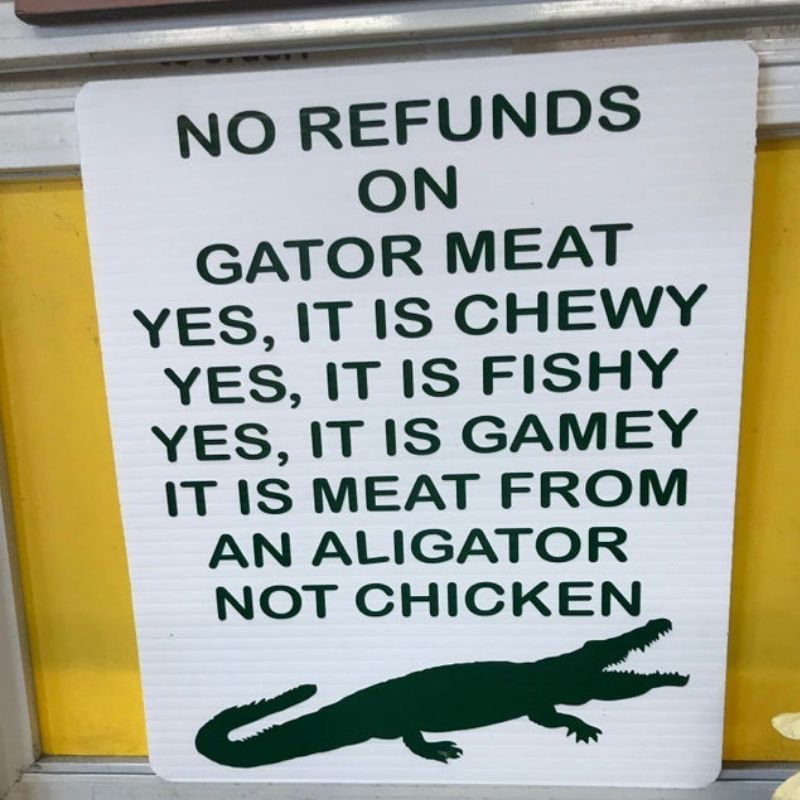 'no refunds on gator meat' sign outside of restaurant