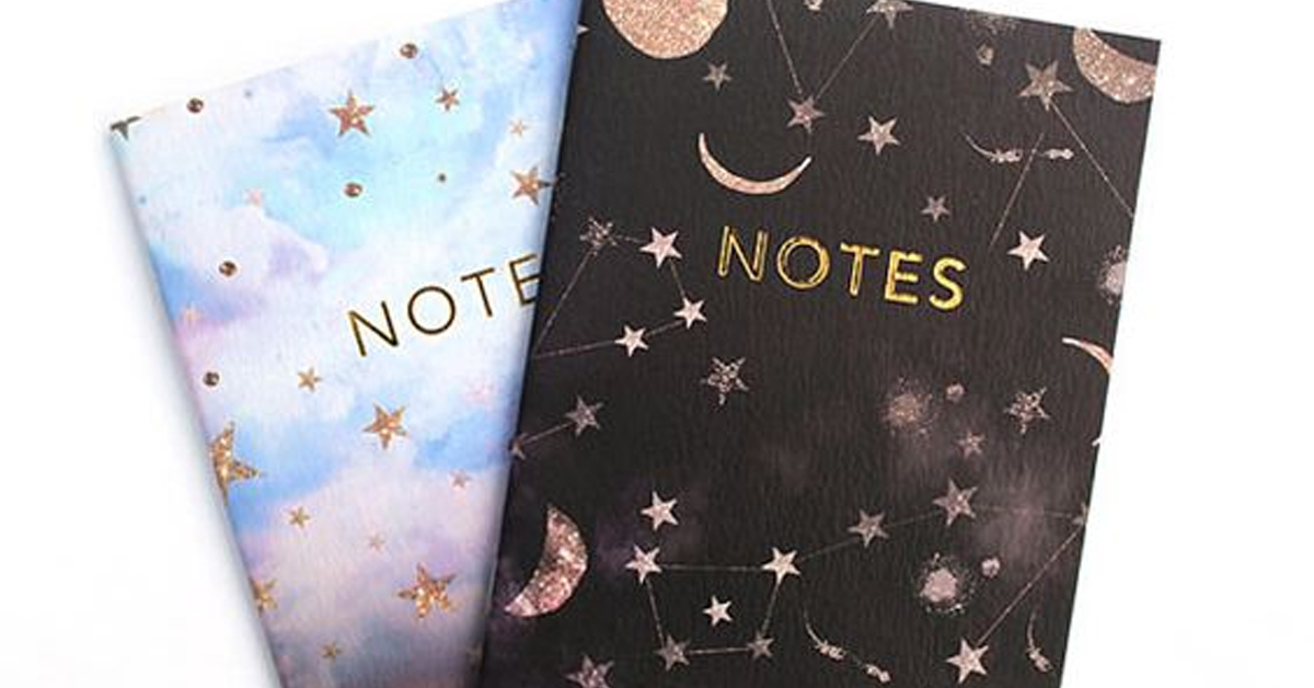 two notebooks with stars and moons