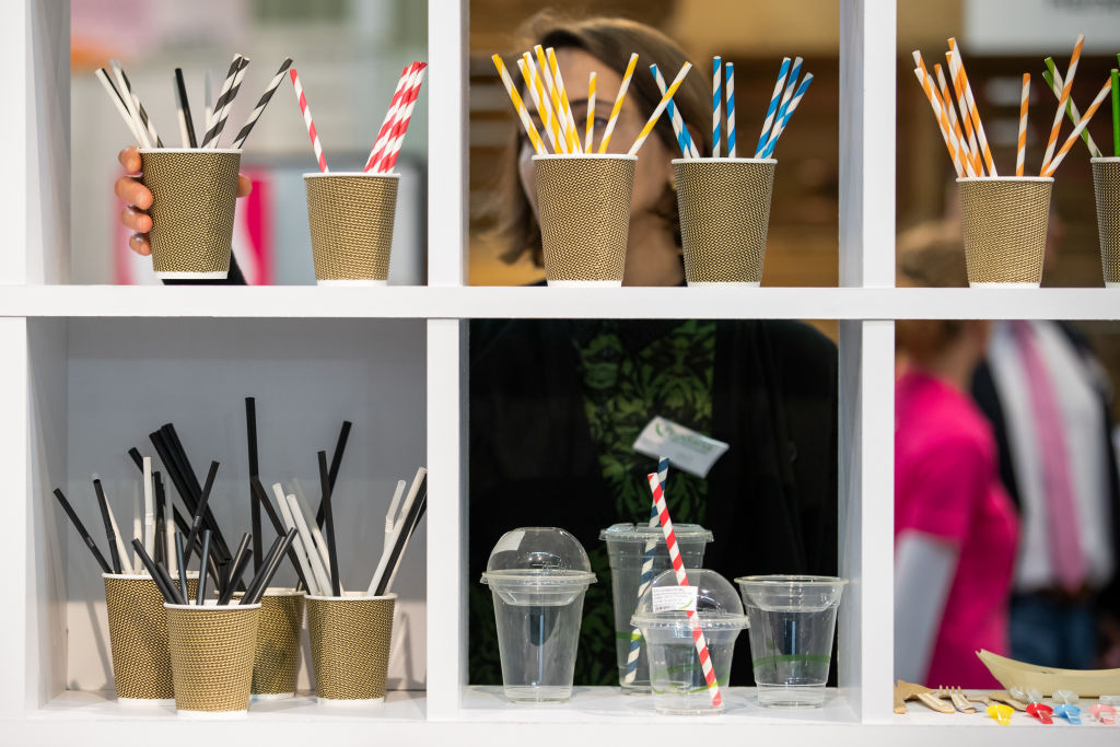 reusable straws displayed in cups on shelves