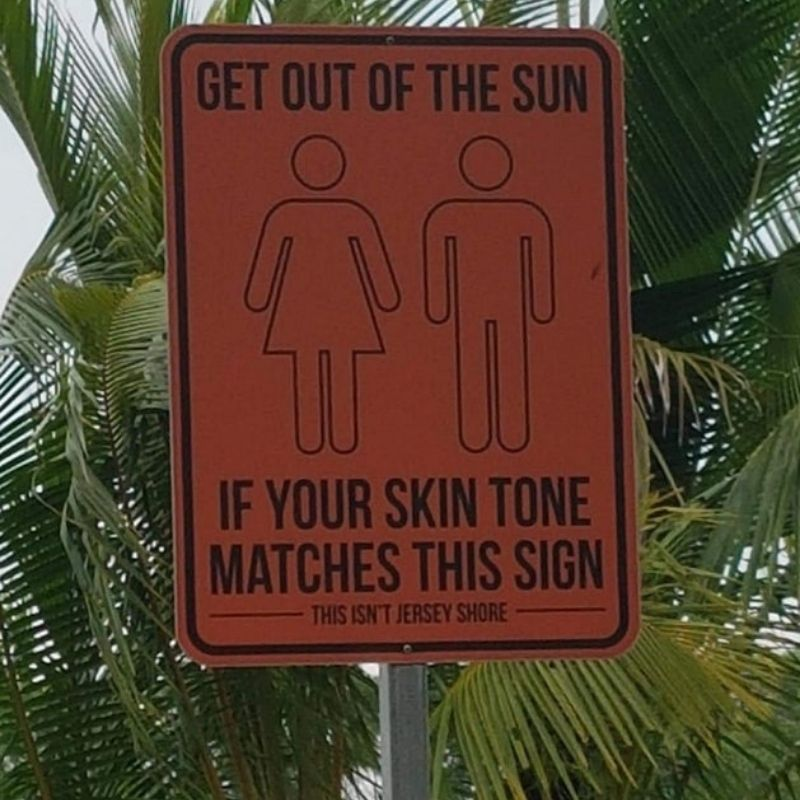 'get out of the sun' warning sign about sunburn in Singapore