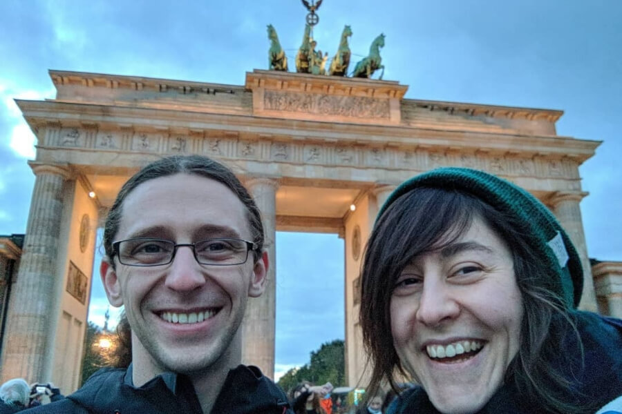 two tourists smiling with teeth