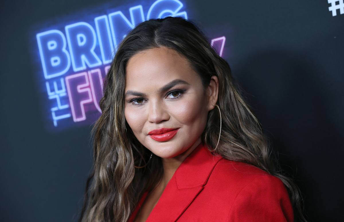 Chrissy Teigen attends the premiere of NBC's