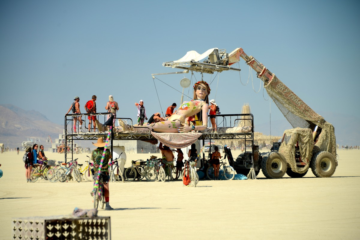 marionetta attached to strings burning man