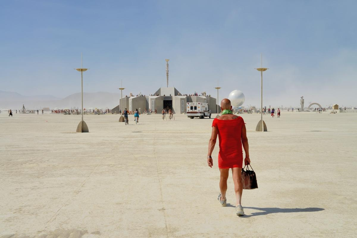 burning man man walking