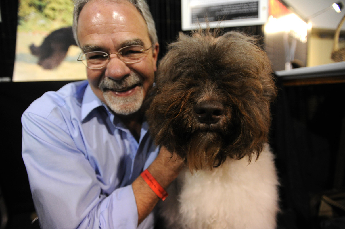 Michel Raymond and Chocovan a 4 year old Barbet at Purina National Dog Show at the International Centre on Mar 10 2012 .