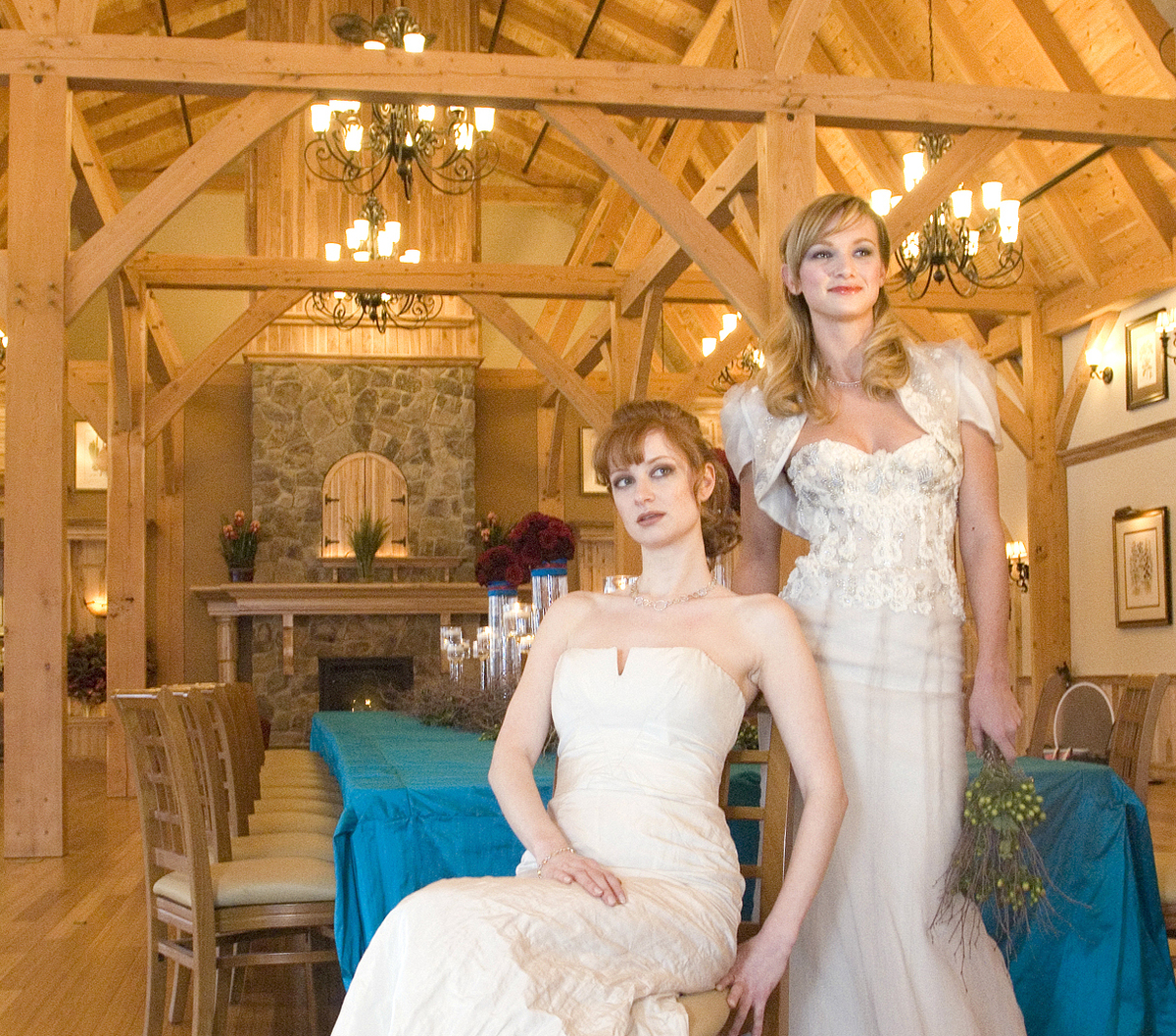 A collaboration between wedding related businesses and models shoot photos in a barn