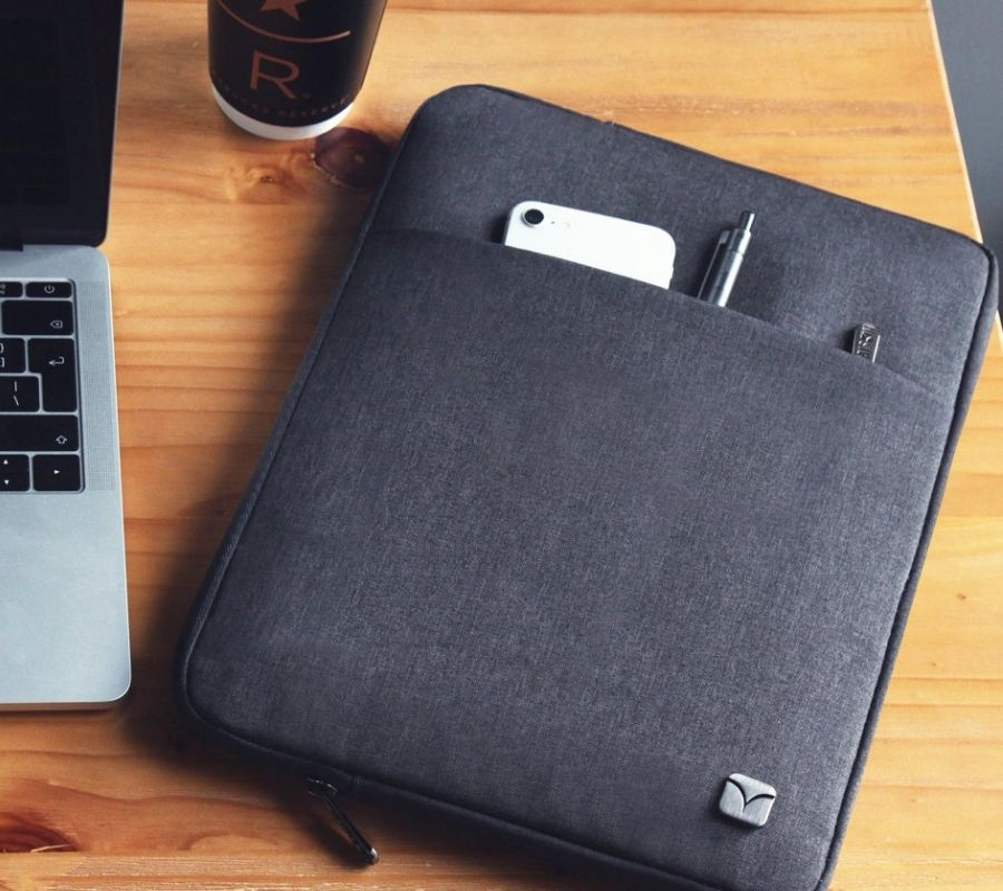nice grey laptop case that can fit phones and computers and stuff into it