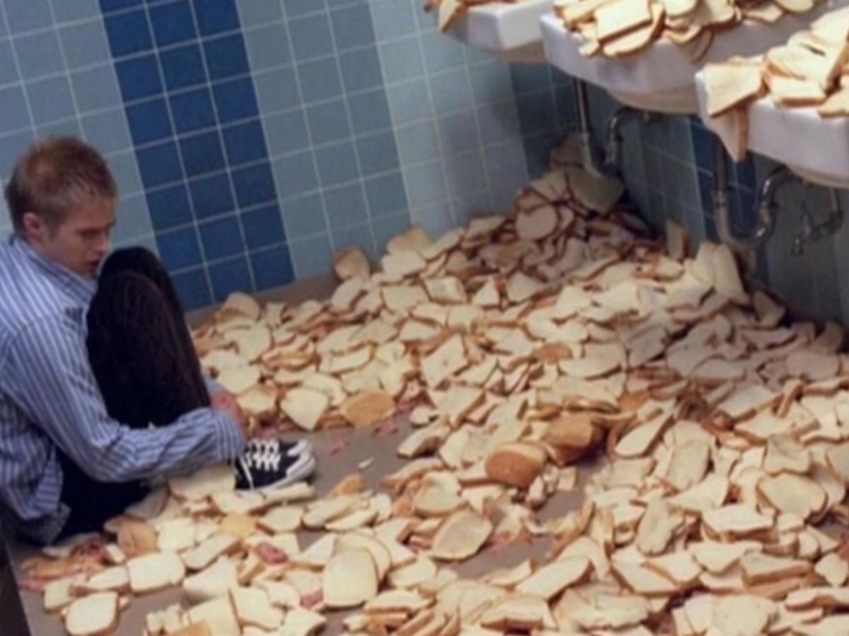 guy surrounded by bread crying in bathroom