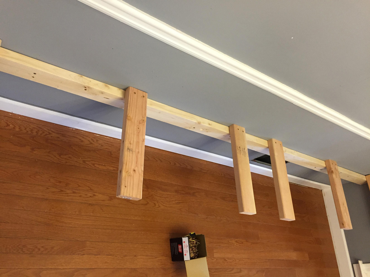 planks attatched to a beam on a wall